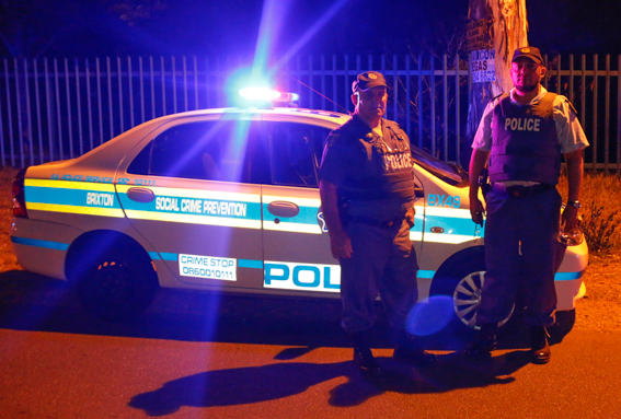 POLICEMAN BY NIGHT: Warrant officers Mohammed and Kruger who have been reservists for almost 20 years at the Brixton police station. Photo: Raquel De Canha