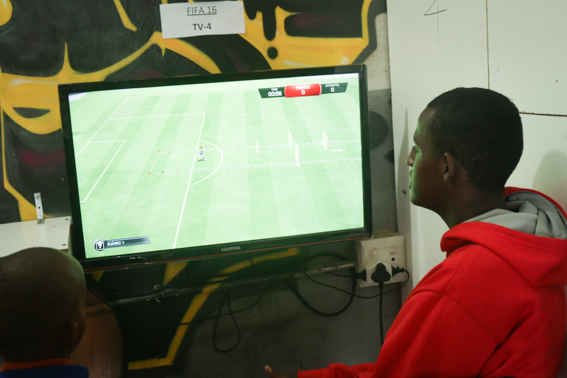 Focused: Mohammed Abdool playing the latest FIFA game in Malelo's store. Photo: Masego Panyane
