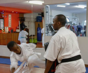 TRAINING: One of Solly's students Vhorifha Ngobele traing with his sensei. Photo: Queenin Masuabi