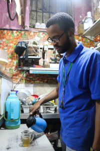 Ali's son, Farhaan making ginger tea in the kitchen. Photo: Sinikiwe Mqadi