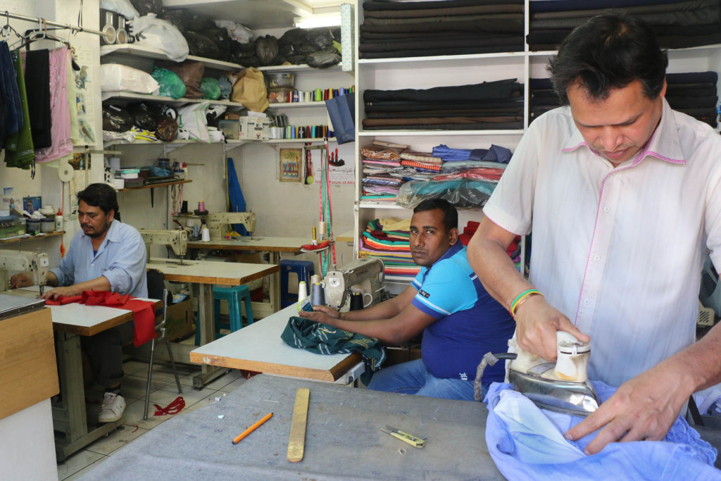 Faruk Mdali, Ismail Hossain and Sunih Rayshanon (left to right), are hard at work even on a Sunday afternoon as their tailor shop, Faruk Tailor Shop, has customers pouring in and out of its doors throughout the week. Photo: Valerie Robinson.